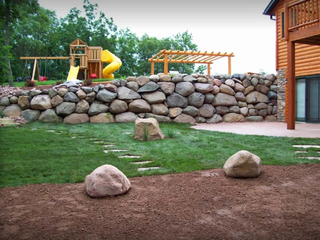 re-landscaping-st-croix-falls-wi-large-rock-retaining-wall